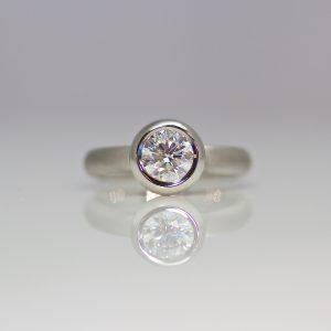 Diamond rub-over set platinum ring