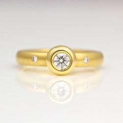 Modern engagement ring rub-over set diamond
