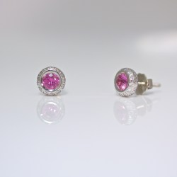 Diamonds set around pink sapphire, platinum ear-studs