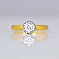 Contemporary engagement ring with diamonds