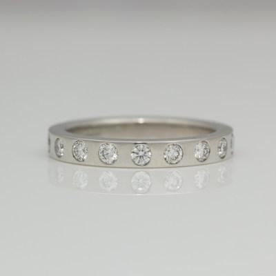 Flat profile ring with flush set diamonds