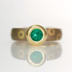 Modern rub-over set emerald ring