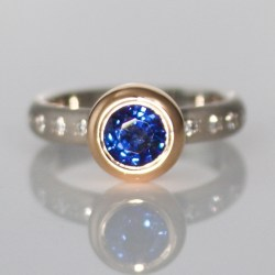 Perfect blue sapphire, rub-over set in rose gold