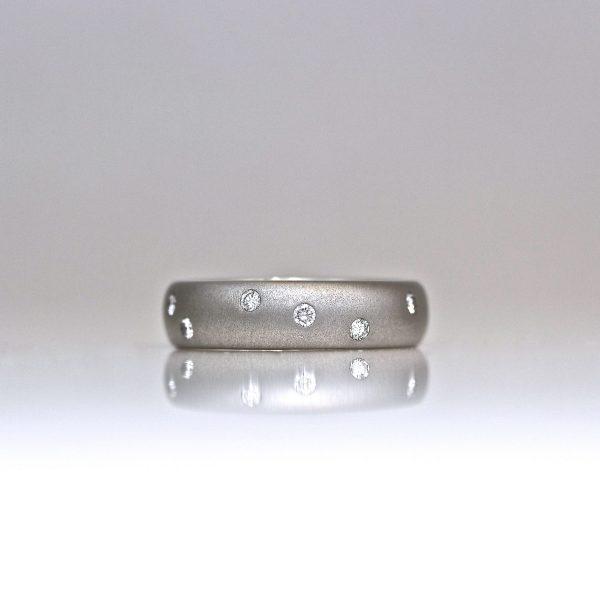 Platinum flush set random diamond ring