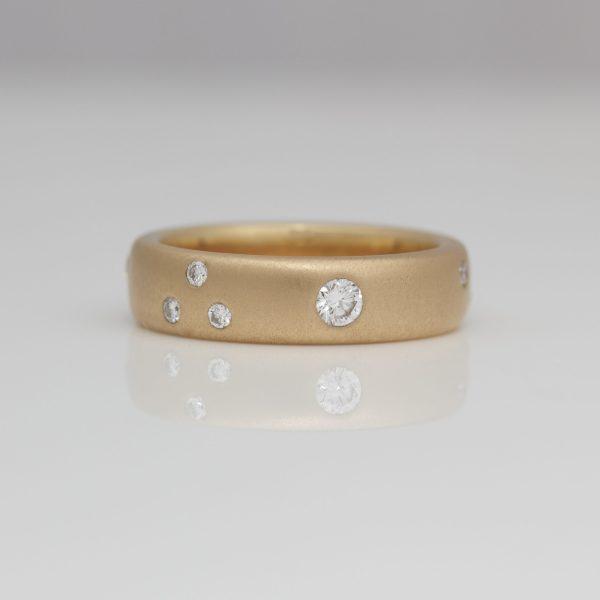 18ct Rose gold ring with randomly flush set diamonds.