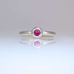 Natural ruby rub-over set in Platinum ring