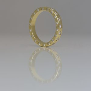 Diamonds set on all edges of 18ct gold ring