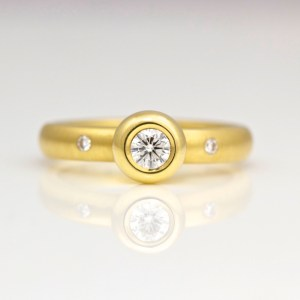 Rub-over diamond solitaire in 18ct yellow gold