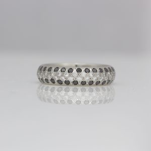 Platinum ring with black & white diamond center stripe.