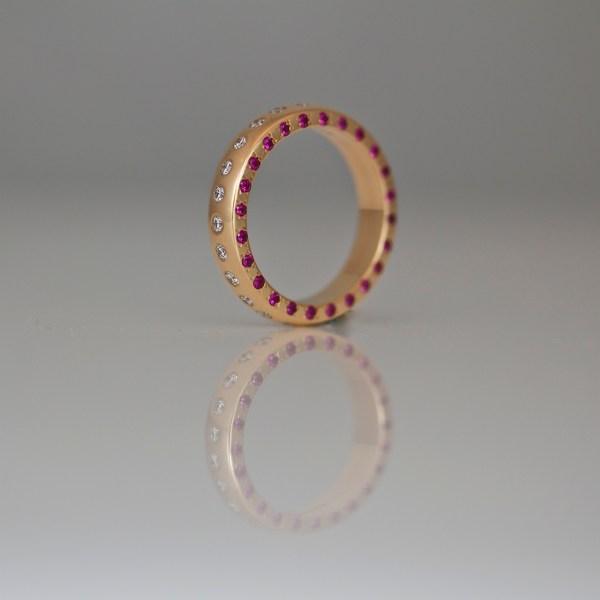 Rubies & diamonds flush set in rose gold ring