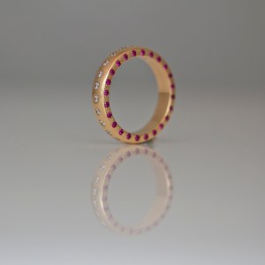 Rubies & diamonds flush set in rose gold ring