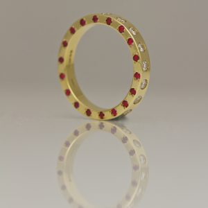 Rubies & diamonds set on three edges in yellow gold ring