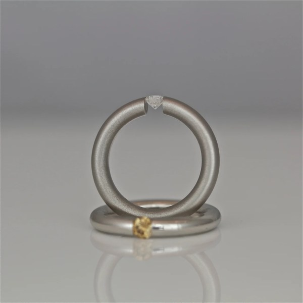 Tension set diamond in platinum ring