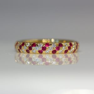 Rubies & diamonds diagonal stripe flush set in yellow gold ring