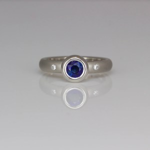 Sapphire rub-over set in platinum ring