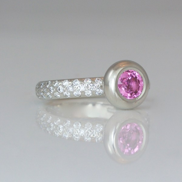 Pink sapphire on diamond set platinum ring 1005