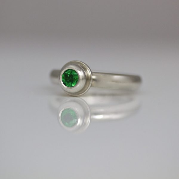 contemporary emerald platinum ring