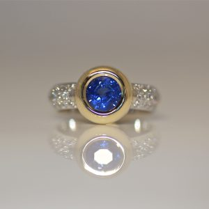 Perfect blue sapphire and diamond engagement ring