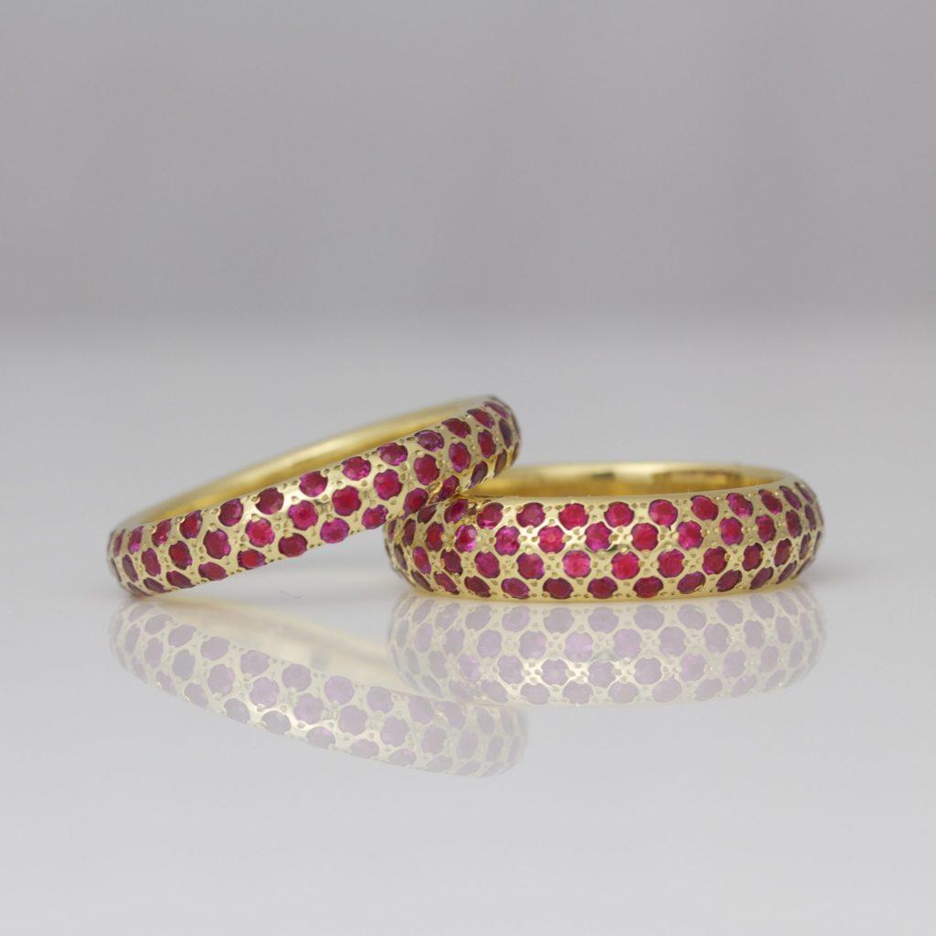 Rubies flush set in gold rings