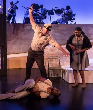 "Sean O'Shea (Policeman), Davon Williams (Jake) and Dawnn Lewis (Serena) in Ensemble Theatre Company's ""Porgy and Bess"" 2/8/17 the New Vic Theatre"