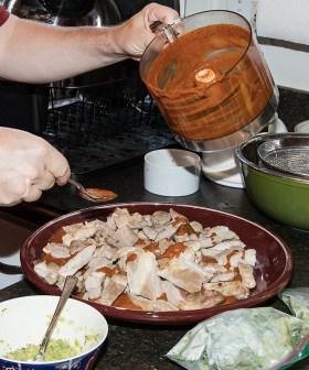 Food and spirits writer Nils Bernstein preparing Mexican turkey entrée for Susanna Vapnek's Fiesta Party 8/5/17 Susanna Vapnek's residence