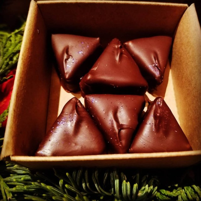 Sarah Bouley Bespoke Chocolate pictured in a box of 6 in triangle shapes