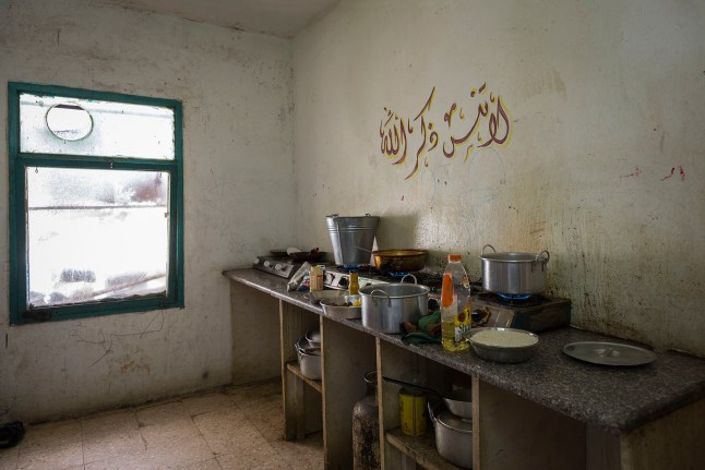 The communal kitchen in a half-finished building that houses Syrian families. The rent is high, almost unaffordable for many families in the building. Many large and extend families have to share a room. Some have to share with a family they've never known before fleeing Syria. The is no privacy, no respite for anyone.