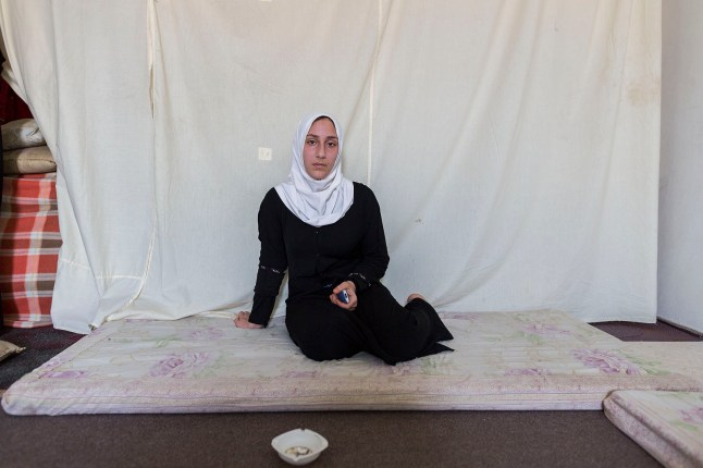"Rima said, ""the most important thing is to be safe. We don't need much more."" She was holding on to her mobile. It's the only way she can stay in touch with her family back home."