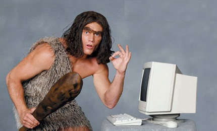 Image result for caveman at a computer