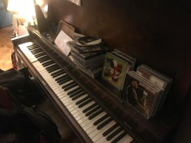 cluttered piano