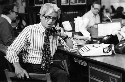 Journalist Charles Wheeler on the phone