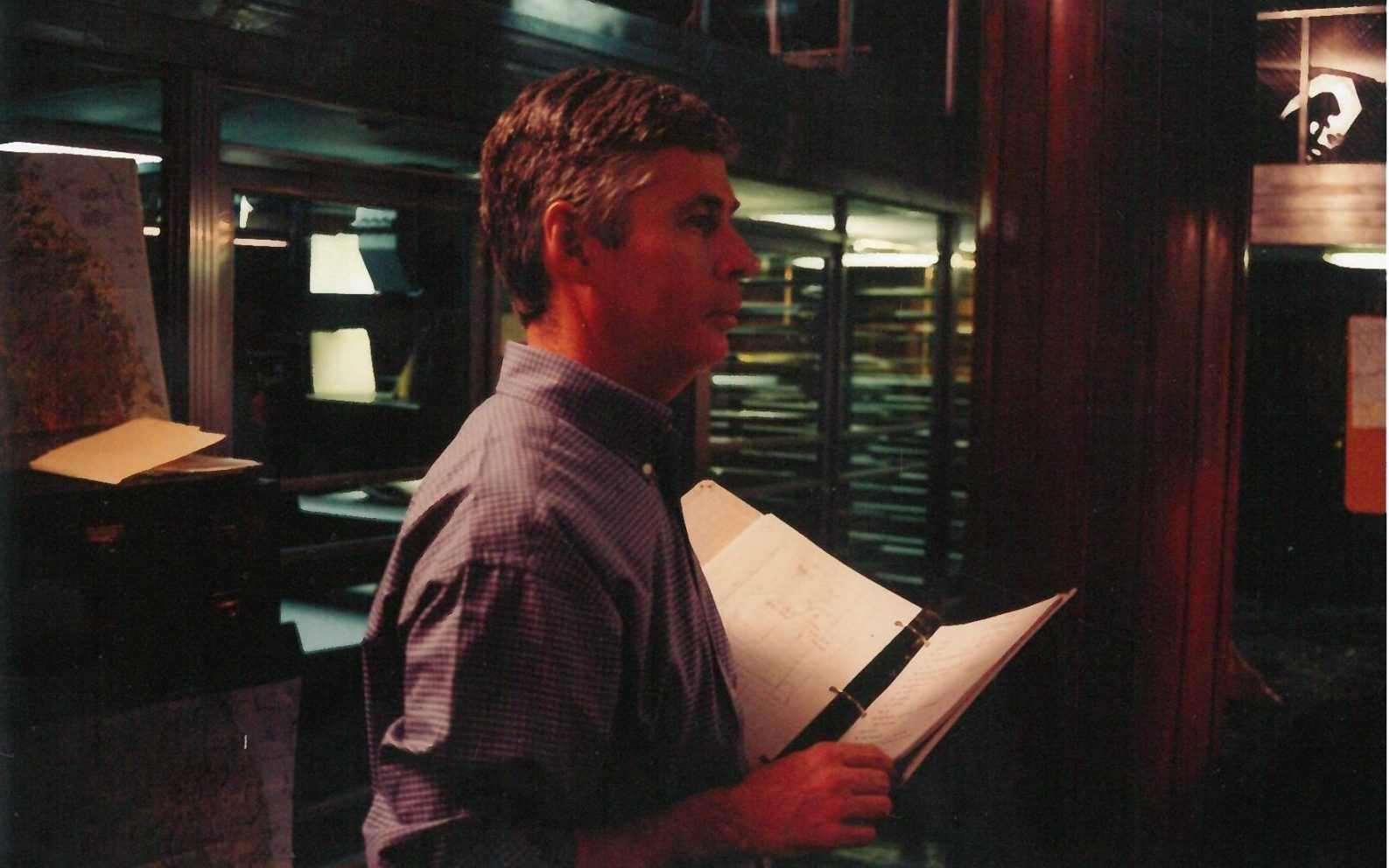 David overseeing the script while filming a reenactment