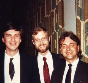 three-shot of men in ties
