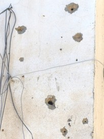 Bullet holes in the wall of the school. Soldiers opened fire on protestors.