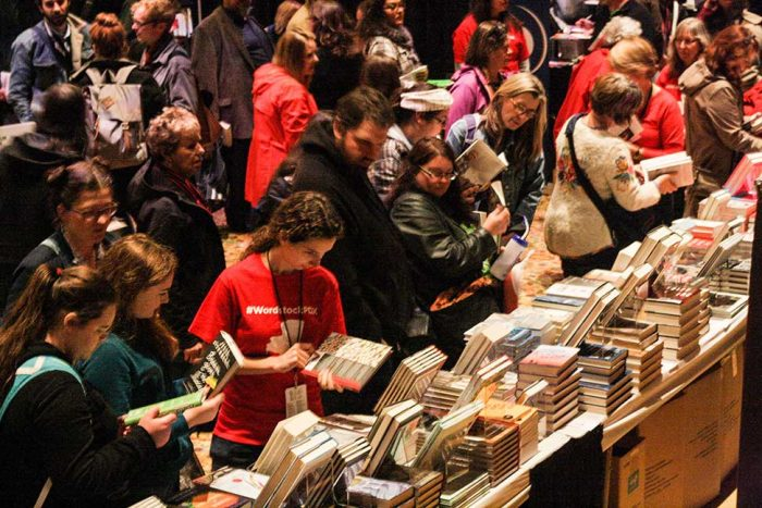 Book fair at Wordstock 2015, readers browsing books on tables