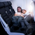Air New Zealand economy Skycouch, young couple stretched out
