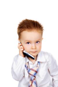Adorable boy listening to a cellphone