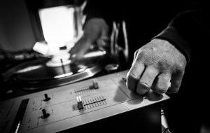 Dj in studio with turntable and mixer