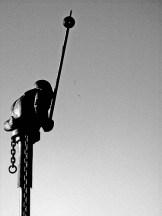 iron-figure-with-chains-wields-baton