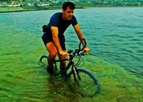 man-cycles-through-sea-towards-st-michaels-mount