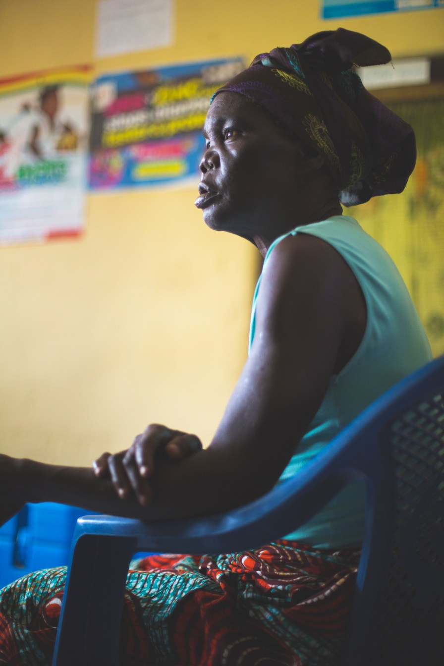 A grandmother waits with her granddaughter at a medical clinic in Ghana.