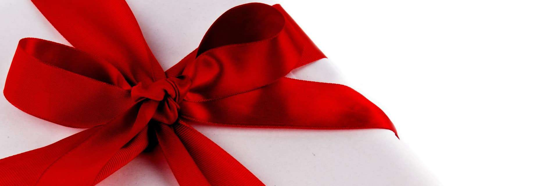 Photo of a red bow on a white gift box