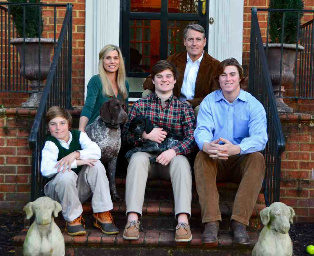David Mize Real Estate Broker family sitting on Home Stairs