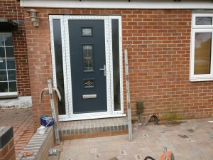 Fitting of new grey composite front door