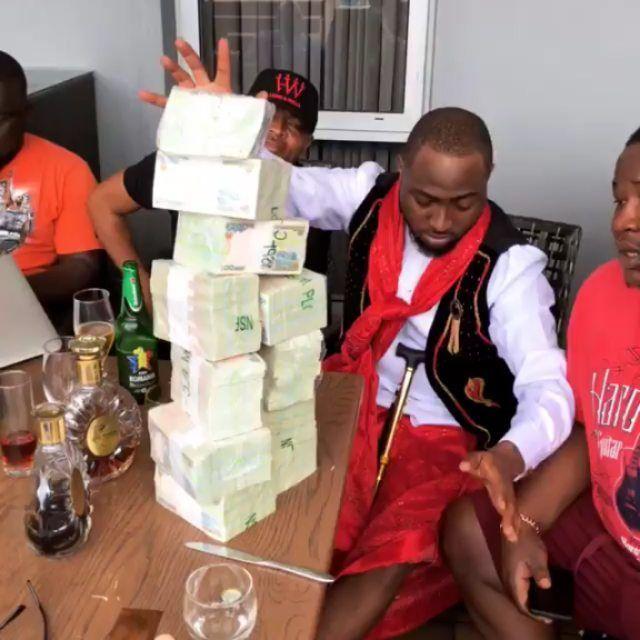 Davido Stacking Money Picture