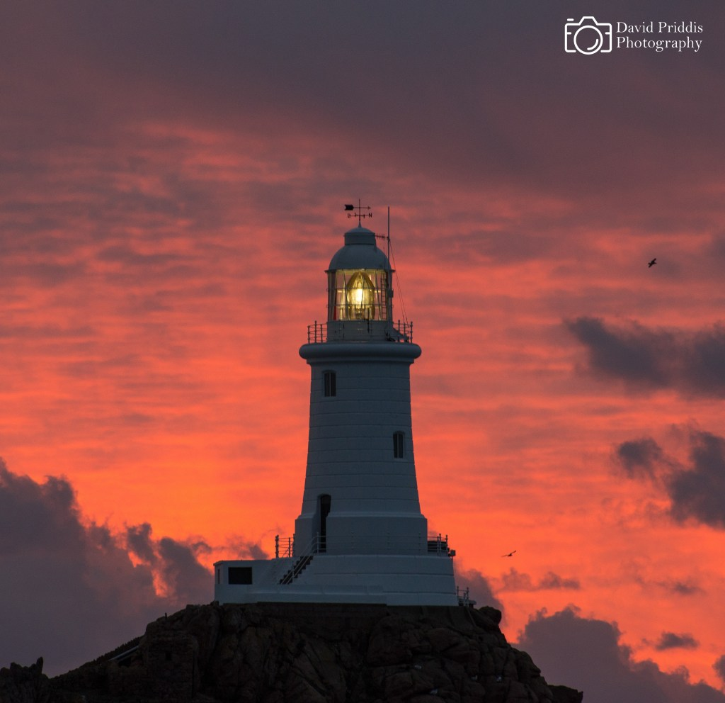 Corbiere Lighthouse with pink clouds