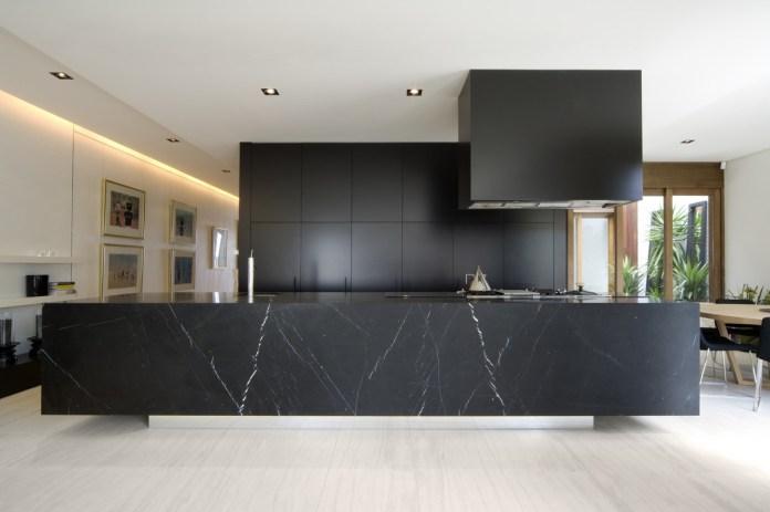 Dark Kitchen with Elegant Marble
