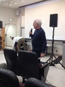 John's colleague speaking about his recollections of John.