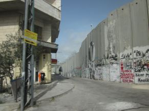 The wall and a building in Bethlehem