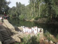 The Jordan River, with many getting baptized